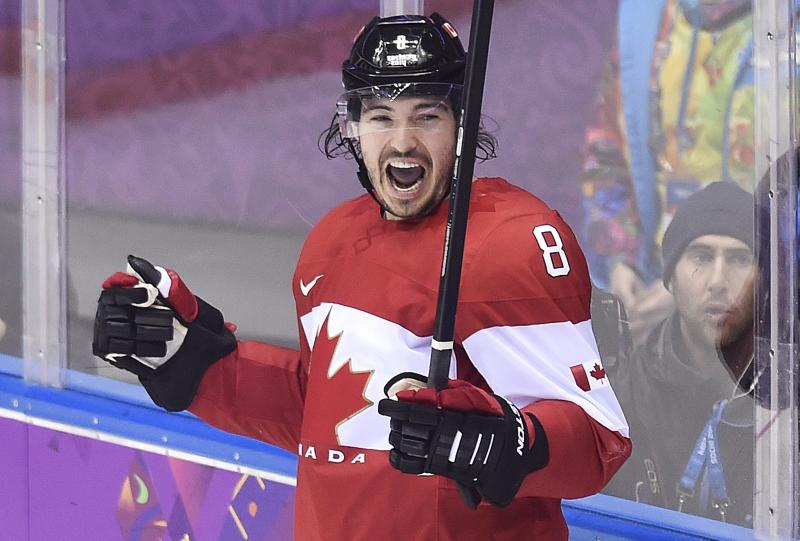 Canada defenseman Drew Doughty celebrates his goal against Finland during overtime in a men's ice hockey game at the Winter Olympics, Sunday, Feb. 16, 2014, in Sochi, Russia. (AP Photo/The Canadian Press, Nathan Denette)