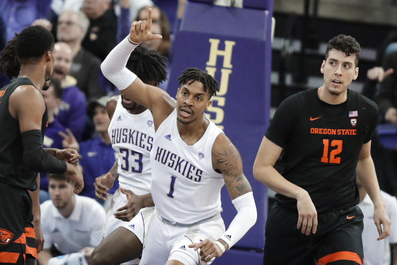 Washington forward Nate Roberts (1) reacts to a play, next to Oregon State center Roman Silva (12) during the first half of an NCAA college basketball game Thursday, Jan. 16, 2020, in Seattle. (AP Photo/Ted S. Warren)