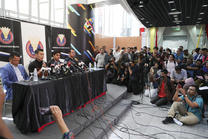 Malaysian badminton player Lee Chong Wei, second from left, speaks during a press conference in Putrajaya, Malaysia, Thursday, June 13, 2019. Former World No. 1-ranked Lee has announced his retirement from badminton after 19 years following his battle with cancer. (AP Photo/Vincent Thian)