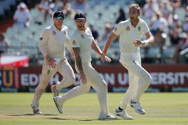 On top: England's Stuart Broad leads the celebrations at Newlands (AFP Photo/MARCO LONGARI)