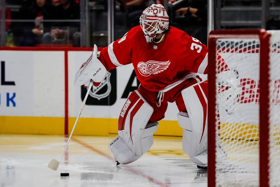 Detroit Red Wings goaltender Alex Nedeljkovic (39) looks before making a pass against the Buffalo Sabres during the second period of a preseason game at Little Caesars Arena in Detroit on Thursday, Sept. 30, 2021.