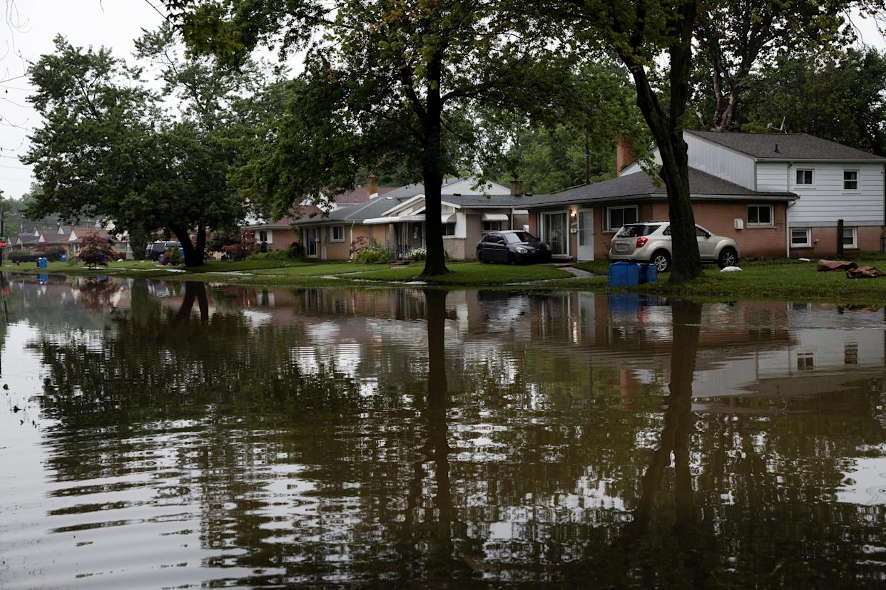 Water floods Hanover Street in Dearborn Heights, Mich., leaving residents unable to leave their homes after heavy rains in July.