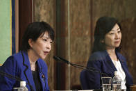 FILE - In this Sept. 18, 2021, file photo, Sanae Takaichi, left, and Seiko Noda, both former internal affairs ministers and candidates for the presidential election of the ruling Liberal Democratic Party, attend a debate session held by Japan National Press club in Tokyo. The stakes are high as Japanese governing party members vote Wednesday, Sept. 29, 2021 for four candidates seeking to replace Yoshihide Suga as prime minister. The next leader must address a pandemic-battered economy, a newly empowered military operating in a dangerous neighborhood, crucial ties with an inward-focused ally, Washington, and tense security standoffs with an emboldened China and its ally North Korea. (AP Photo/Eugene Hoshiko, Pool, File)
