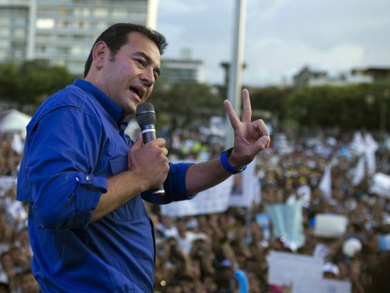 Former president Jimmy Morales speaks to supporters during a campaign rally in Guatemala City (AP)