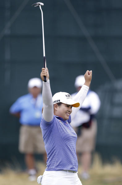 Inbee Park, of South Korea, reacts after sinking her last putt of the tournament on the 18th green during the final round at the U.S. Women's Open golf tournament at Sebonack Golf Club in Southampton, N.Y., Sunday, June 30, 2013. Inbee Kim won the championship, shooting 8 under-par. (AP Photo/Frank Franklin II)