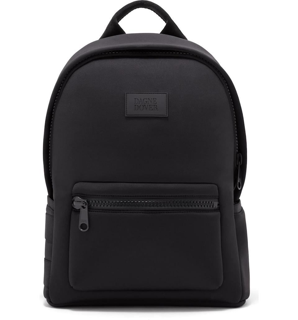 """This durable neoprene backpack is sleek and stylish. It's extremely roomy and can double as a <a href=""""https://www.teenvogue.com/gallery/best-travel-backpacks?mbid=synd_yahoo_rss"""" rel=""""nofollow noopener"""" target=""""_blank"""" data-ylk=""""slk:travel backpack"""" class=""""link rapid-noclick-resp"""">travel backpack</a>. $175, Nordstrom. <a href=""""https://www.nordstrom.com/s/dagne-dover-medium-dakota-neoprene-backpack/5327363"""" rel=""""nofollow noopener"""" target=""""_blank"""" data-ylk=""""slk:Get it now!"""" class=""""link rapid-noclick-resp"""">Get it now!</a>"""