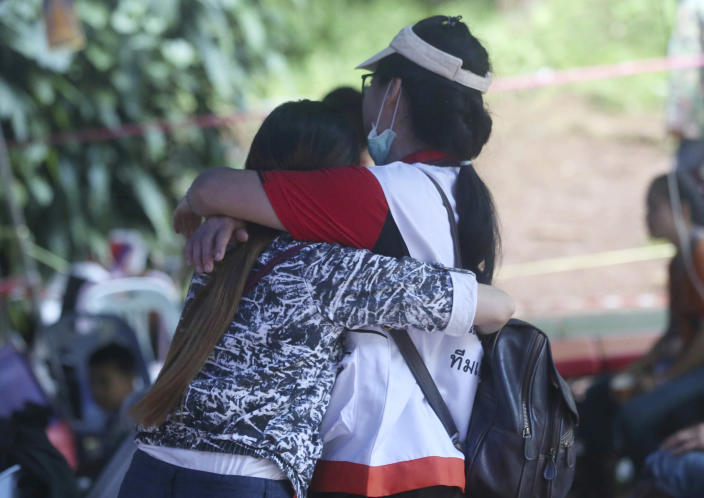 <p>A family member, left, and a Thai official hug each other near a cave where 12 boys and their soccer coach are trapped, in Mae Sai, Chiang Rai province, in northern Thailand, July 5, 2018. (Photo: Sakchai Lalit/AP) </p>