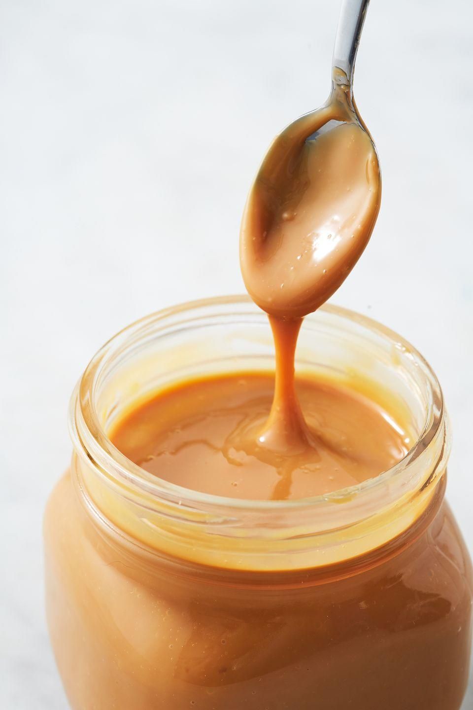 "<p>The sauce that should be used on everything, from ice cream to coffee!</p><p>Get the recipe from <a href=""https://www.delish.com/cooking/recipe-ideas/a27244513/dulce-de-leche-recipe/"" rel=""nofollow noopener"" target=""_blank"" data-ylk=""slk:Delish"" class=""link rapid-noclick-resp"">Delish</a>. </p>"