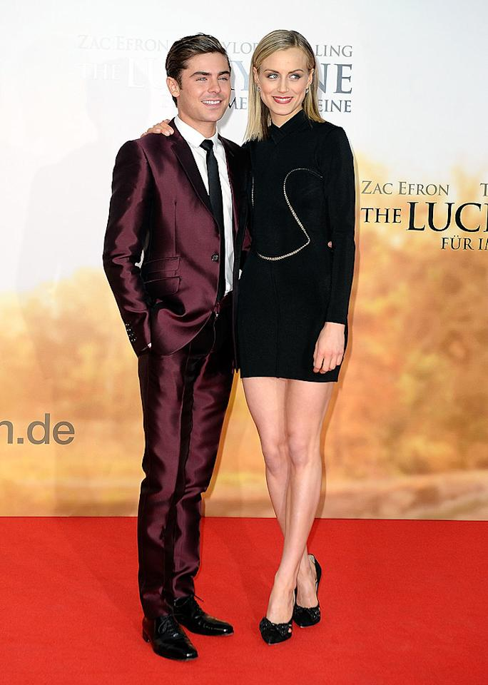 """On Wednesday, Zac Efron and Taylor Schilling attended the German premiere of """"The Lucky One"""" at CineStar in Berlin, and both of the film's leads looked fabulous. Zac opted for a maroon George Clinton suit and black accents, while Taylor donned an interesting Alaia dress and Jimmy Choo heels. I can't get enough of these two! Can you? (4/25/2012)"""