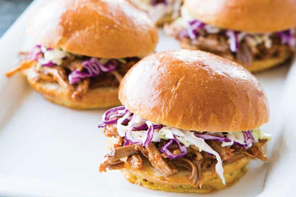 """Making pulled-pork barbecue in the slow cooker works really well. And the excess pork stock created by this recipe can be saved for future soups or used for cooking <a href=""""https://www.epicurious.com/expert-advice/how-to-cook-whole-grains-quinoa-farro-millet-spelt-rye-bulgur-rice-recipes-article?mbid=synd_yahoo_rss"""" rel=""""nofollow noopener"""" target=""""_blank"""" data-ylk=""""slk:grains"""" class=""""link rapid-noclick-resp"""">grains</a>. <a href=""""https://www.epicurious.com/recipes/food/views/carolina-style-pork-bbq-sandwiches?mbid=synd_yahoo_rss"""" rel=""""nofollow noopener"""" target=""""_blank"""" data-ylk=""""slk:See recipe."""" class=""""link rapid-noclick-resp"""">See recipe.</a>"""