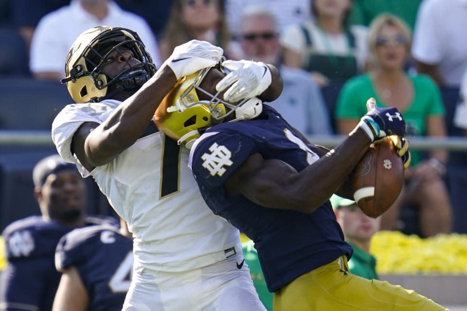 Purdue cornerback Jamari Brown (7) breaks up a pass to Notre Dame wide receiver Kevin Austin Jr. (4) during the second half of an NCAA college football game in South Bend, Ind., Saturday, Sept. 18, 2021. Notre Dame defeated Purdue 27-13. (AP Photo/Michael Conroy)