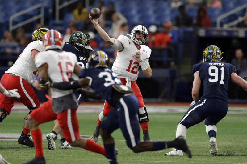 East quarterback James Morgan, of Florida International, (12) throws a pass against the East during the first half of the East West Shrine football game Saturday, Jan. 18, 2020, in St. Petersburg, Fla. (AP Photo/Chris O'Meara)