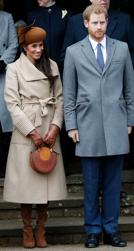 <p>For her first Christmas with the royal family, Meghan donned a camel-hued coat by Canadian label, Sentaler (£986). She accessorised the festive look with a £900 circle bag by Chloé and £630 Stuart Weitzman boots. Her hat is believed to have been custom-made by milliner Jane Taylor – cost unknown. <em>[Photo: Getty]</em> </p>