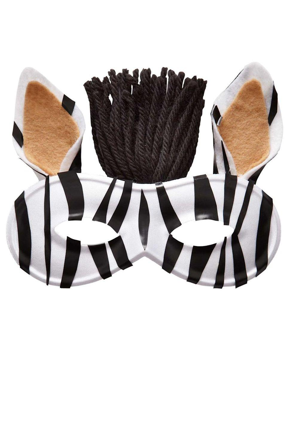 <p>Stripes have never been so fashionable than on this zebra mask. <br></p><p>1. Trim pieces of electrical tape to create varied zebra stripes. Adhere to the mask, pressing down edges with a fingernail.</p><p>2. Cut two ear shapes from the white felt and two slightly smaller ones from the tan felt. Add black tape stripes to white pieces. Layer white and tan pieces together and fold in at the base to form ears. Glue to the back of the mask. Let set.</p><p>3. Trim a handful of black yarn into 4-inch lengths; attach to the back of the mask with hot glue, forming a tuft. Spritz with hairspray to stiffen the yarn. Let dry.</p>
