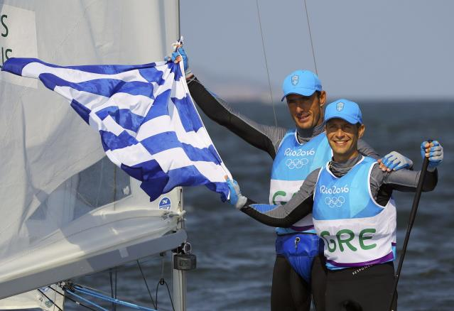 2016 Rio Olympics - Sailing - Final - Men's Two Person Dinghy - 470 - Medal Race - Marina de Gloria-Rio de Janeiro, Brazil - 18/08/2016. Panagiotis Mantis (GRE) of Greece and Pavlos Kagialis (GRE) of Greece celebrate winning bronze medal. REUTERS/Brian Snyder FOR EDITORIAL USE ONLY. NOT FOR SALE FOR MARKETING OR ADVERTISING CAMPAIGNS.
