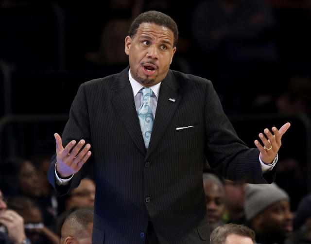 Providence head coach Ed Cooley talks to a referee during the first half of an NCAA men's college basketball game against St. John's in the quarterfinals of the Big East tournament at Madison Square Garden, Thursday, March 13, 2014 in New York. (AP Photo/Seth Wenig)