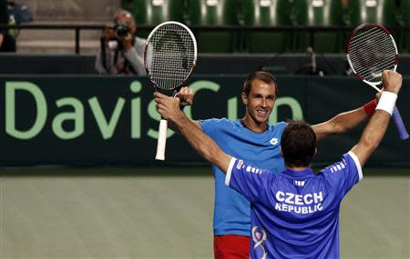 Rosol and Stepanek of Czech Republic celebrate after winning their Davis Cup men's doubles quarter-final tennis match against Japan's Ito and Uchiyama in Tokyo