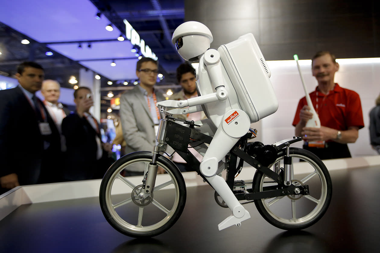 Murata Boy, a bicycle riding robot, rides a bike at the Murata booth at the at the International Consumer Electronics Show.