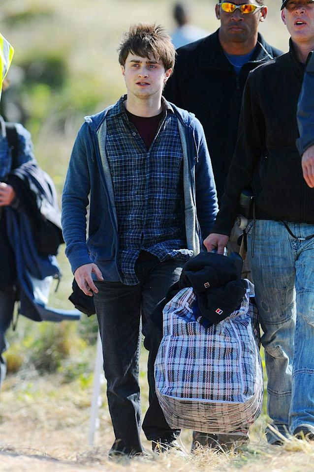 """Daniel Radcliffe was spotted on the set of """"Harry Potter and the Deathly Hallows"""" in West Wales. Unlike the other """"Potter"""" films, """"Hallows"""" will be released in two parts -- Part 1 on November 19, 2010 and Part 2 on July 15, 2011. Wales News Service/<a href=""""http://www.splashnewsonline.com"""" target=""""new"""">Splash News</a> - May 11, 2009"""