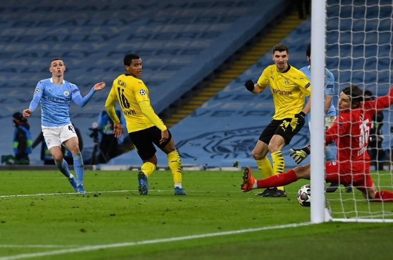 Just in time: Phil Foden (left)struck Manchester City's late winner against Borussia Dortmund