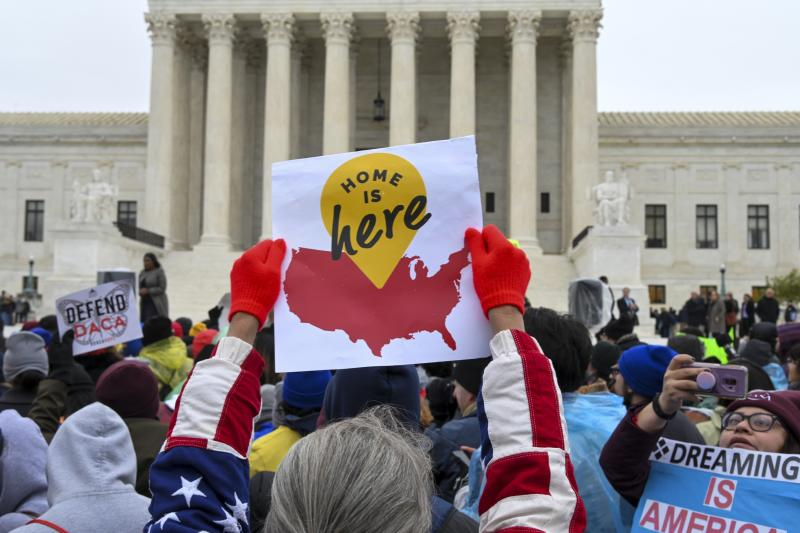 """WASHINGTON, DC - NOVEMBER 12: Demonstrators gather in front of the United States Supreme Court, where the Court is hearing arguments on Deferred Action for Childhood Arrivals - DACA - that could impact the fates of nearly 700,000 """"dreamers"""" brought to the United States as undocumented children, on Tuesday, November 12, 2019, in Washington, DC. The Donald Trump administration has tried for more than two years to wind down the Deferred Action for Childhood Arrivals (DACA) program, announced by President Barack Obama in 2012 to protect from deportation qualified young immigrants who came to the country illegally. (Photo by Jahi Chikwendiu/The Washington Post via Getty Images)"""