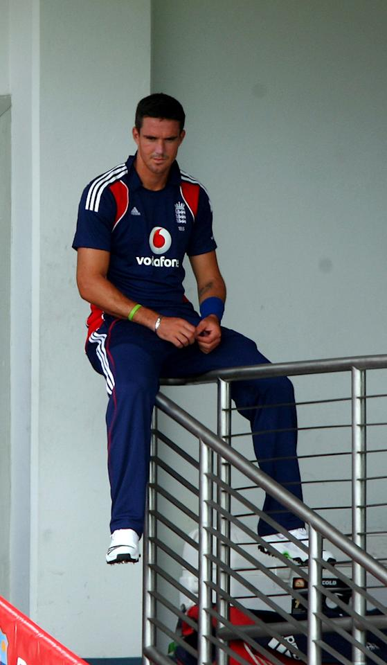 Kevin Pietersen sits on the players balcony as rain delayed the start of The 3rd One Day International played between The West Indies and England at The Kensington Oval on March 27, 2009 in Bridgetown, Barbados.  (Photo by Julian Herbert/Getty Images) *** Local Caption *** Kevin Pietersen