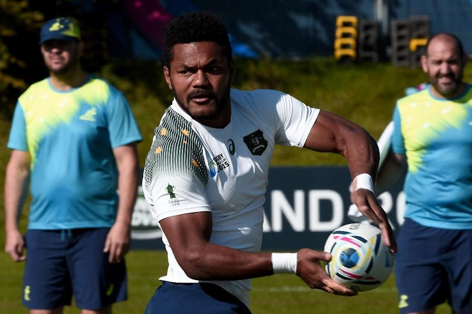 Australia's wing Henry Speight passes the ball during a team training session at Bath University, south west England, on September 26, 2015 during the Rugby Union World Cup (AFP Photo/Damien Meyer)