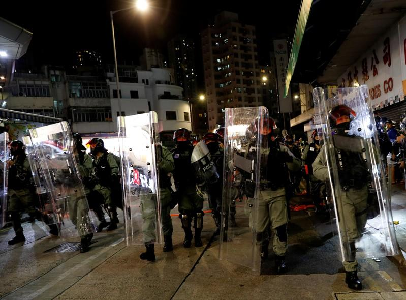 Riot police disperse pro-democracy demonstrators gathering to commemorate the three-month anniversary of an assault by more than 100 men on protesters, commuters and journalists, in Hong Kong