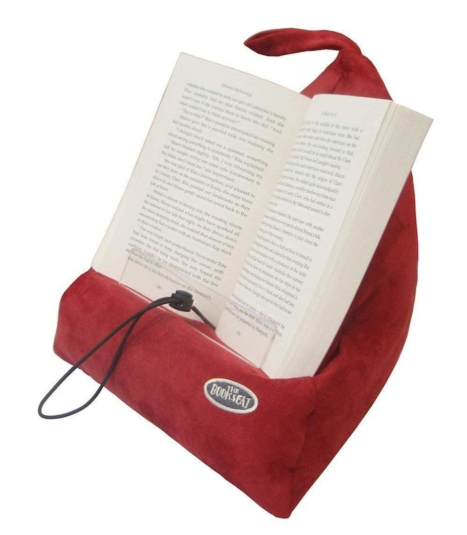 <p><span>The Book Seat</span> ($40) is useful because it holds your book, but it can also be a great travel pillow.</p>