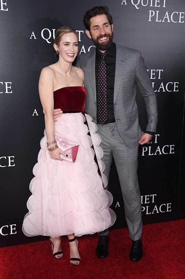 <p>Emily wowed in a fairytale Oscar de la Renta number at the premiere of 'A Quiet Place in April 2018. Meanwhile, the British actress' husband, John Krasinski, paired his full beard with a pale grey suit. <em>[Photo: Getty]</em> </p>