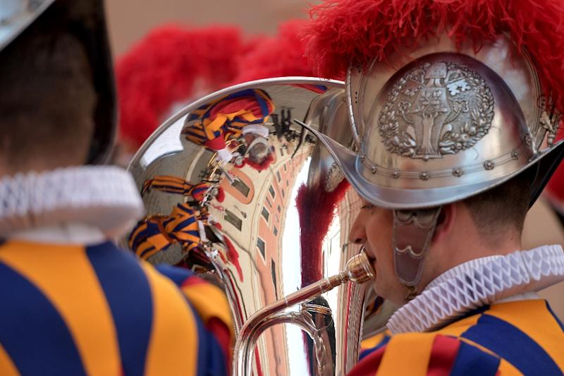Swiss guards join a long line of traditional pope protectors (AFP Photo/Tiziana FABI)