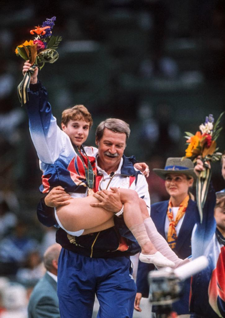 An injured Kerri being carried by Bela Karolyi after the medal ceremony
