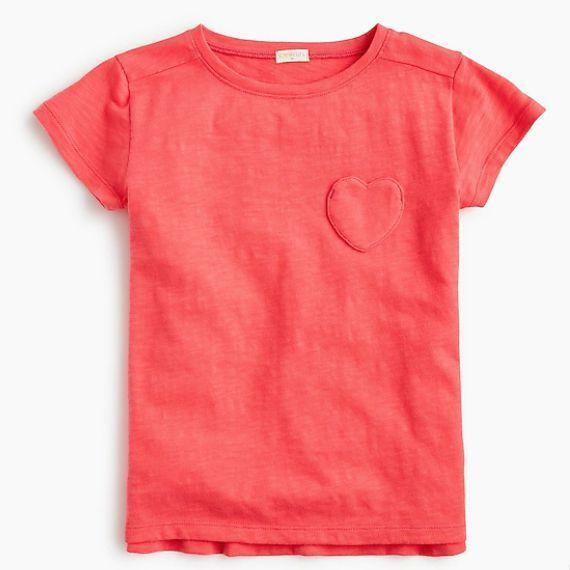 """<p><strong>J. Crew</strong></p><p>jcrew.com</p><p><strong>$19.50</strong></p><p><a href=""""https://go.redirectingat.com?id=74968X1596630&url=https%3A%2F%2Fwww.jcrew.com%2Fp%2FJ2253&sref=https%3A%2F%2Fwww.goodhousekeeping.com%2Fholidays%2Fgift-ideas%2Fg4923%2Fvalentine-gifts-for-kids%2F"""" rel=""""nofollow noopener"""" target=""""_blank"""" data-ylk=""""slk:Shop Now"""" class=""""link rapid-noclick-resp"""">Shop Now</a></p><p>This sweet shirt is the perfect thing to wear to the class party — it's thematic without going overboard with hearts. It also comes in six colors, including gray, mint green, lilac, white (good for <a href=""""https://www.goodhousekeeping.com/clothing/a32802945/how-to-tie-dye/"""" rel=""""nofollow noopener"""" target=""""_blank"""" data-ylk=""""slk:tie-dying"""" class=""""link rapid-noclick-resp"""">tie-dying</a>) and navy blue, so you can grab one in their favorite shades.</p>"""