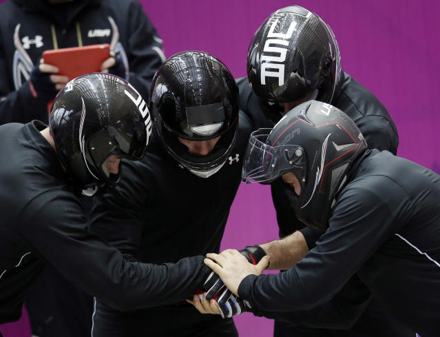 The team from the United States USA-1, piloted by Steven Holcomb, prepare for a run during the men's four-man bobsled training at the 2014 Winter Olympics, Thursday, Feb. 20, 2014, in Krasnaya Polyana, Russia. (AP Photo/Michael Sohn)