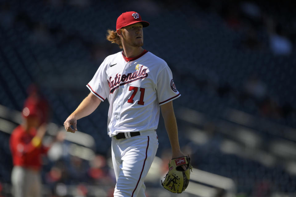 Washington Nationals relief pitcher Mason Thompson walks back to the dugout after he was pulled during the sixth of a baseball game against the Philadelphia Phillies, Thursday, Sept. 2, 2021, in Washington. (AP Photo/Nick Wass)