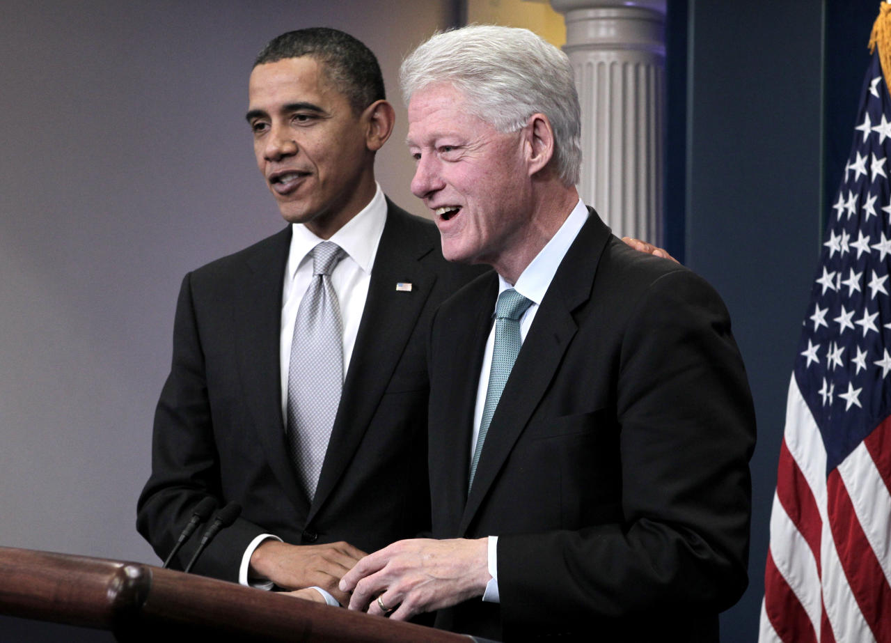 Former President Bill Clinton joins President Barack Obama in the White House briefing room in Washington, Friday, Dec. 10, 2010, to talk about Obama's urging of the Congress to move on the tax compromise he made with Republican congressional leaders.