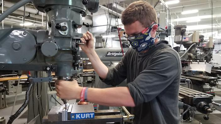 Justin Haessly, 23, works in the machine tool operation lab at Waukesha County Technical College. The college returned to some in-person classes June 1.