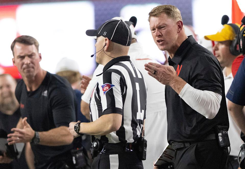 Nebraska coach Scott Frost protests a delay of game penalty for use of illegal signals, during the first half of the team's NCAA college football game against Michigan on Saturday, Oct. 9, 2021, in Lincoln, Neb.