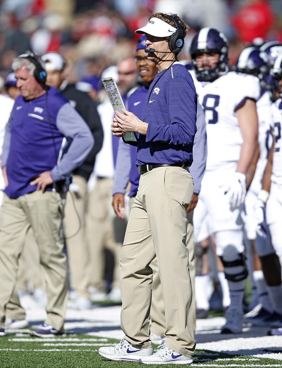 FILE - TCU offensive coordinator Sonny Cumbie waits for the time out during the second half of the NCAA college football game against Texas Tech in Lubbock, Texas, in this Saturday, Nov. 18, 2017, file photo (AP Photo/Brad Tollefson, File)