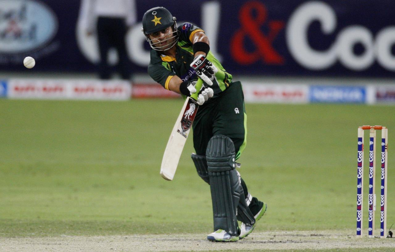 Pakistan's Ahmed Shahzad plays a shot during their second Twenty20 international cricket match against South Africa in Dubai November 15, 2013. REUTERS/Nikhil Monteiro(UNITED ARAB EMIRATES - Tags: SPORT CRICKET)