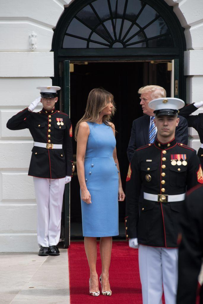 <p>FLOTUS awaited the Panamanian President and his wife in a formfitting. sky blue dress, which she paired with floral pumps.</p>