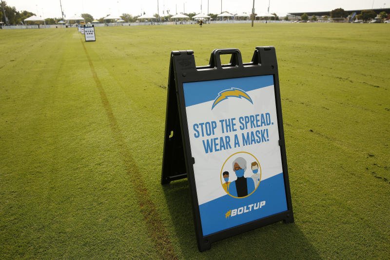 "A sign that says ""Stop the spread. Wear a mask!"" at the Los Angeles Chargers' practice."