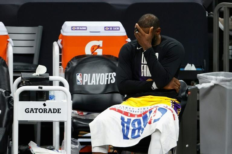 Draining - Los Angeles star LeBron James reacts during the Lakers' game-five loss to the Phoenix Suns, who would go on to win their NBA 1st round playoff series in six games