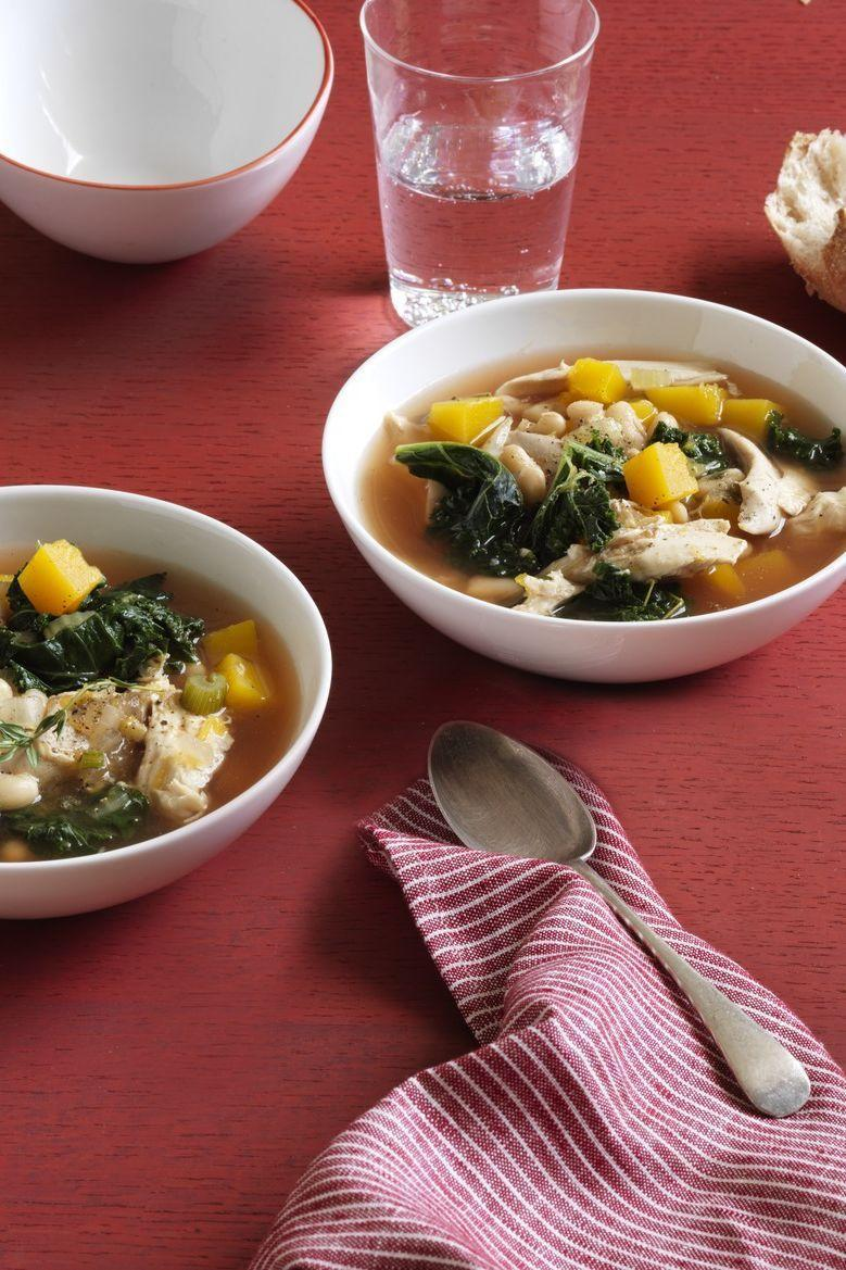 """<p>Use store-bought rotisserie chicken instead of cooking your own to make this easy half-hour recipe.</p><p><a href=""""https://www.womansday.com/food-recipes/food-drinks/recipes/a12551/kale-white-bean-butternut-squash-soup-recipe-wdy0214/"""" rel=""""nofollow noopener"""" target=""""_blank"""" data-ylk=""""slk:Get the Kale, White Bean, and Butternut Squash Soup recipe."""" class=""""link rapid-noclick-resp""""><strong><em>Get the Kale, White Bean, and Butternut Squash Soup recipe. </em></strong></a></p>"""