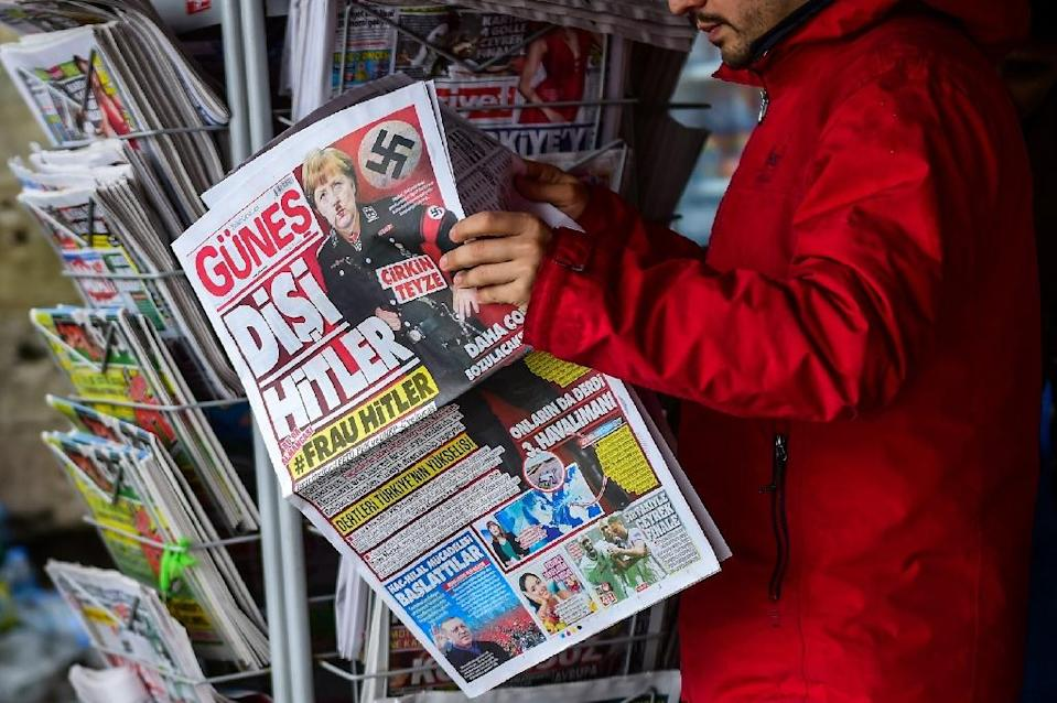 German Chancellor Angela Merkel has come under fire in Turkey, with the pro-government daily Gunes depicting her in a Nazi uniform on its frontpage on March 17 (AFP Photo/YASIN AKGUL)