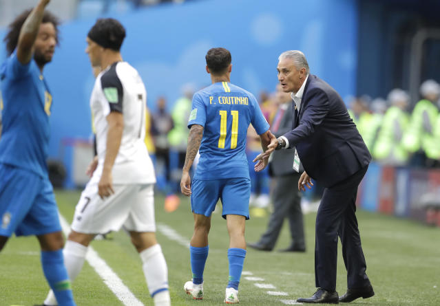 Brazil head coach Tite, right, speaks to Brazil's Philippe Coutinho during the group E match between Brazil and Costa Rica at the 2018 soccer World Cup in the St. Petersburg Stadium in St. Petersburg, Russia, Friday, June 22, 2018. (AP Photo/Petr David Josek)