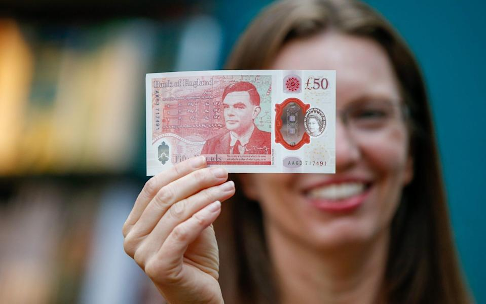 Sarah John, chief cashier of the Bank of England, poses with a new £50 banknote