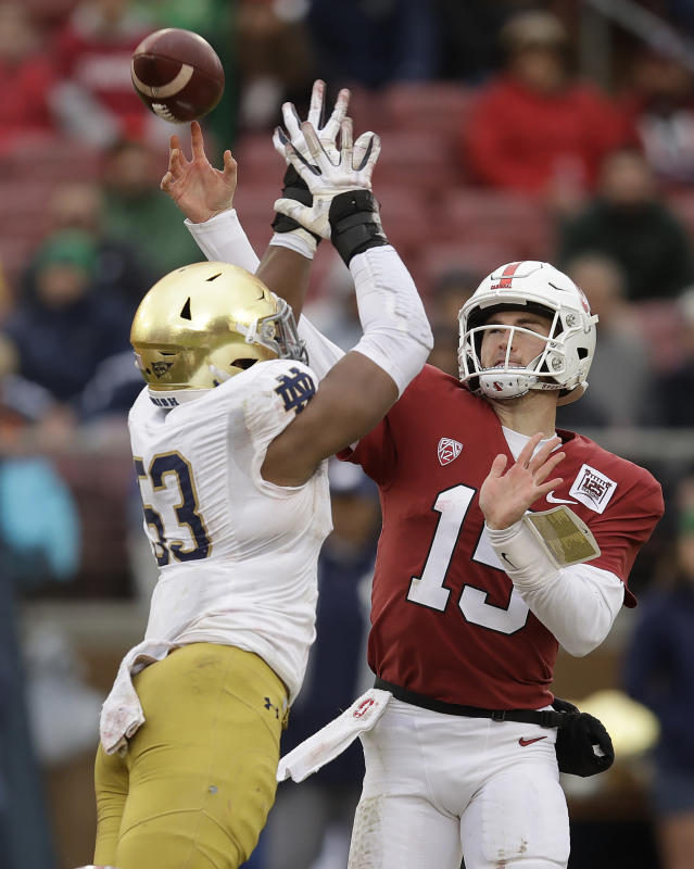 Stanford quarterback Davis Mills, right, passes over Notre Dame's Khalid Kareem (53) in the first half of an NCAA college football game Saturday, Nov. 30, 2019, in Stanford, Calif. (AP Photo/Ben Margot)