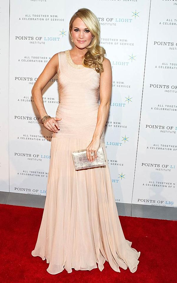 "Meanwhile in Washington, D.C. at the Points of Light Institute's tribute to former President George H.W. Bush, country cutie Carrie Underwood nearly took our breath away in an ethereal, blush-colored Herve Leger by Max Azria gown. Paul Morigi/<a href=""http://www.wireimage.com"" target=""new"">WireImage.com</a> - March 21, 2011"