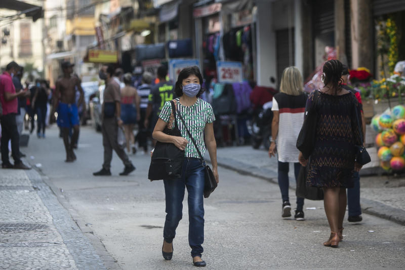 RIO DE JANEIRO, BRAZIL - JUNE 08: A woman wearing a mask walks in the Saara commercial center on the first monday of quarantine relaxing in the city amidst the coronavirus (COVID-19) pandemic on June 8, 2020 in Rio de Janeiro, Brazil. A decree signed by Governor Wilson Witzel established the easing of social isolation in the state of Rio de Janeiro, with partial reopening of bars, restaurants and shopping malls. The return of football and other high-performance sports is also authorized by the government. (Photo by Bruna Prado/Getty Images)